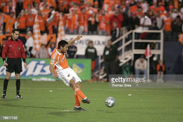 Houston's Brian Ching scores his penalty kick during the MLS Cup match between the New England Revolution and the Houston Dynamo at Pizza Hut Park in...