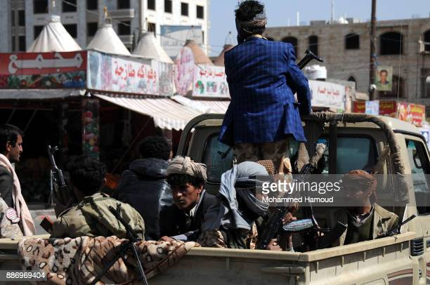 Houthi fighters are seen on a truck during clashes with forces of expresident Ali Abdullah Saleh before he was killed on December 04 2017 at a street...
