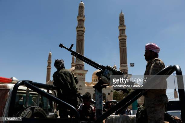 Houthi fighters guard during a ceremony held for collecting supplies for their fighters in the battle fronts, on September 22, 2019 in Sana'a, Yemen.