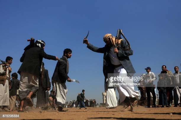 Houthi fighters perform the Yemeni traditional Barra dancing as they take part in a tribal gathering staged to reinforce front lines where they...