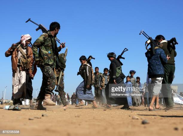 Houthi fighters perform Yemeni traditional Barra dancing as they take part in a tribal gathering staged to reinforce front lines where they fighting...