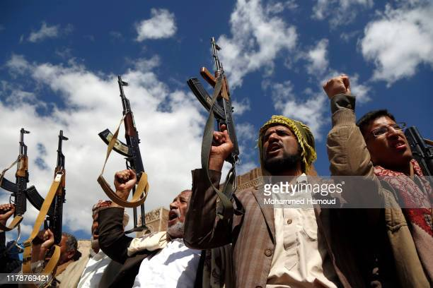 Houthi followers hold their guns during a tribal gathering against the continued war and blockade on October 03 2019 in Sana'a Yemen