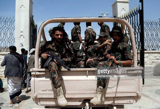 Houthi forces ride a truck during a funeral of fighters, killed in the ongoing fighting between the Houthis and forces of the government over the...