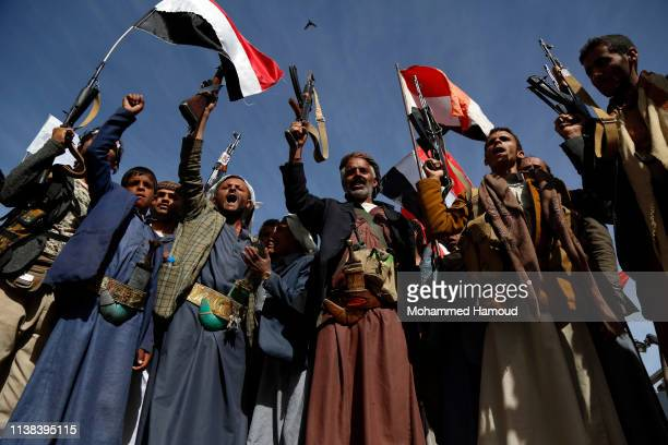 Houthi loyalists chant slogans during a rally held to mark the fourth anniversary of the war on March 26, 2019 in Sana'a, Yemen.