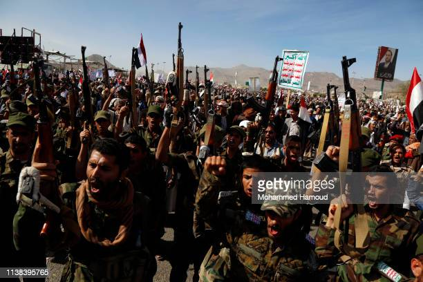Houthi loyalists chant slogans during a rally to mark the fourth anniversary of the war on March 26, 2019 in Sana'a, Yemen.