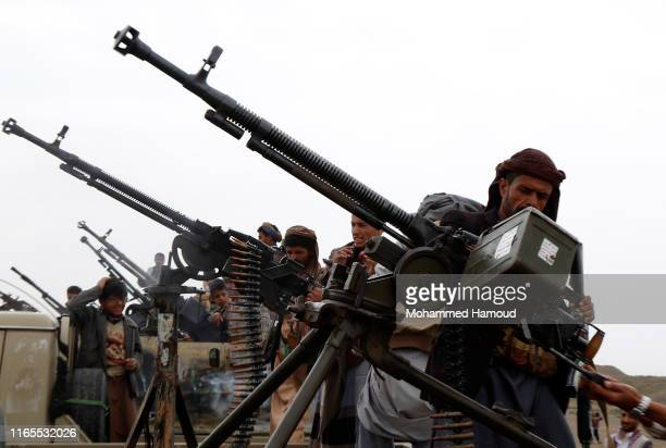 Houthi loyalists check weapons on military trucks during a tribal gathering on August 01, 2019 in Sana'a, Yemen. Rebels in Yemen fired a ballistic...