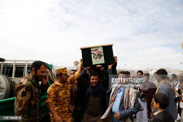 Houthi mourners carry coffins of fighters killed in the ongoing battle against forces of the government, during a funeral ceremony on November 25,...