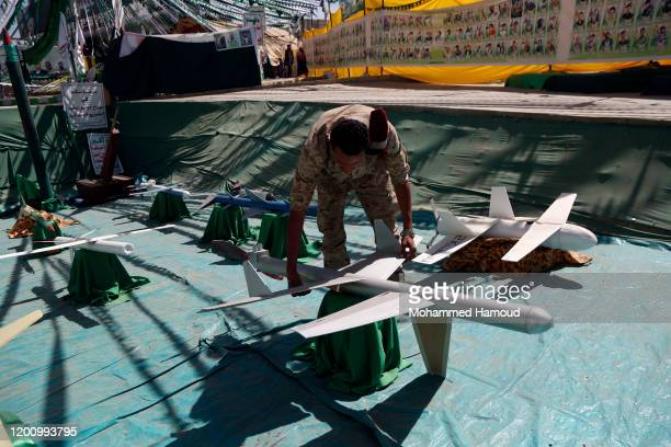 Houthi soldier inspects models of missiles and drones made by school children to be displayed during the annual martyr week on January 21, 2020 in...