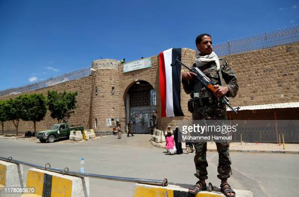 Houthi soldier stands guard outside the central prison during the release of 350 prisoner of the government forces arrested in the ongoing war, on...