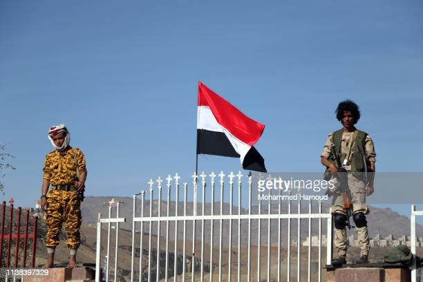 Houthi soldiers stand guard during a rally to mark the fourth anniversary of the war on March 26 2019 in Sana'a Yemen