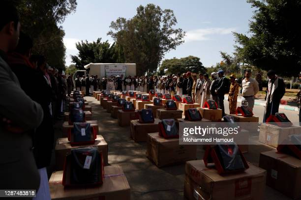 Houthi supporters gather during a ceremony staged to send clothes to fighters on November 24, 2020 in Sana'a, Yemen. According to reports the Trump...