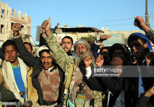 Houthi supporters shout slogans during a rally in the streets to celebrate the killing of the expresident Ali Abdullah Saleh a day after he was shot...