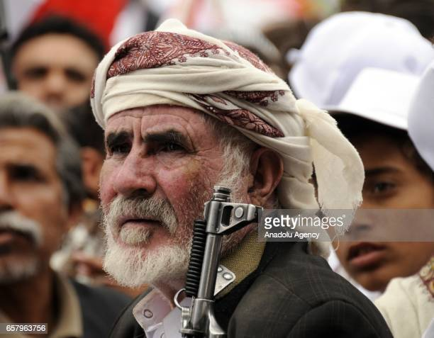 Houthis and supporters of ousted leader Ali Abdullah Saleh gather to protest the Saudiled operations during a rally on the second anniversary of the...