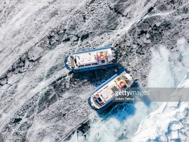 hovercraft transport on the frozen lake baikal, siberia, russia. aerial view - russia stock pictures, royalty-free photos & images