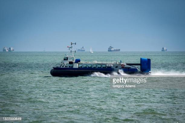 hovercraft traveling from the isle of wight to portsmouth england - portsmouth england stock pictures, royalty-free photos & images