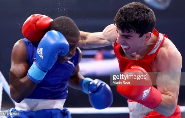 Hovhannes Bachkov of Armenia and Andy Cruz Gomez of Cuba fight in the Men's light welter during the semi finals of the AIBA World Boxing...