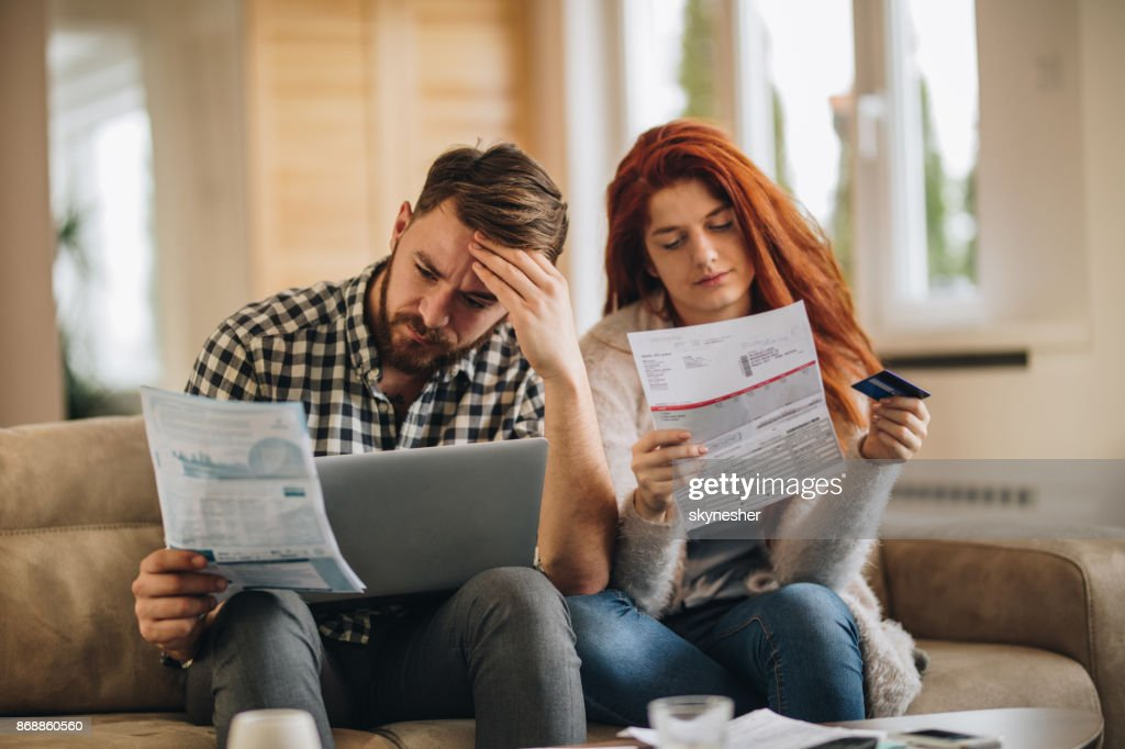 How are we going to pay these bills? : Stock Photo
