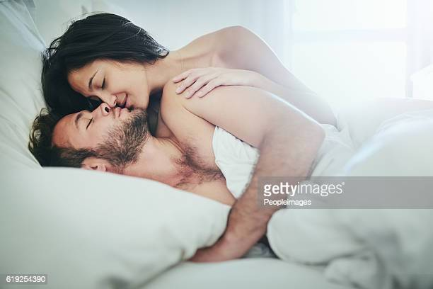 how did i get to be so lucky? - couple and kiss and bedroom stock photos and pictures