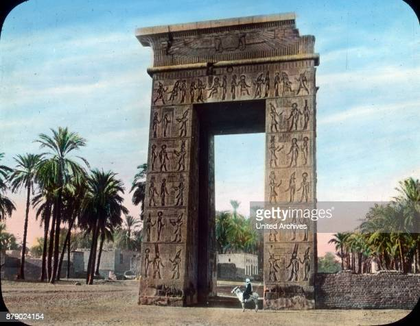 How great big pylon this is that we can call as the gateway to the outer temple complex which proves the size ratio between the donkey driver and the...