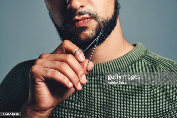 how he keeps his beard looking good - beard stock pictures, royalty-free photos & images