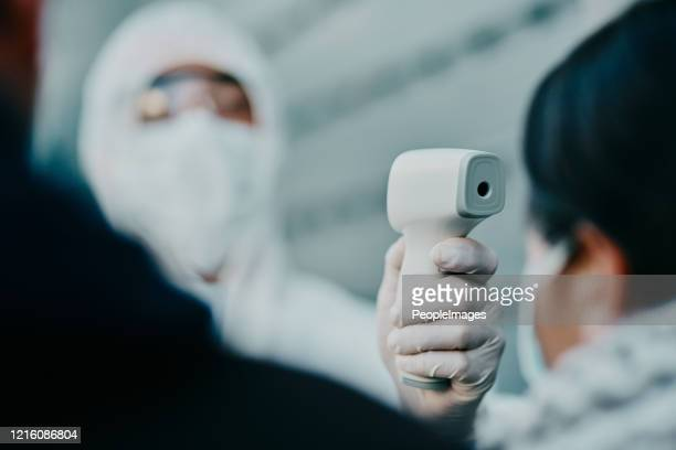 how high is your temperature? - infrared thermometer stock pictures, royalty-free photos & images
