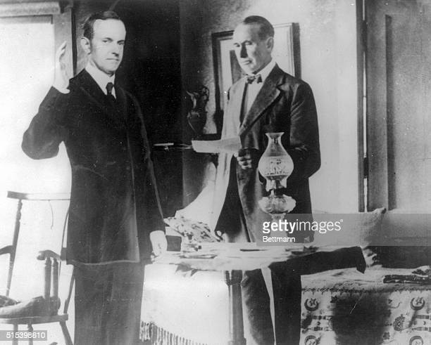 How President Coolidge appeared in a room at his father's house when he took the oath of office by kerosene light is shown here Coolidge took office...