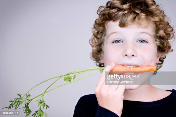 how to encourage a child to eat his vegetables - carrot stock pictures, royalty-free photos & images