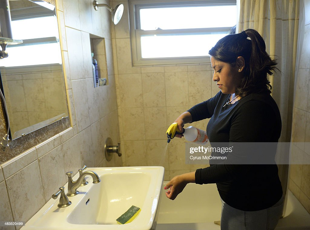 How to hire a housecleaning service for your home. Yareli Gonzalez of Wendy's Cleaning Service sprays a bathroom sink as she cleans a home in Denver on Tuesday, April 8, 2014.