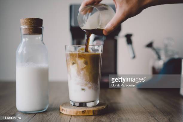 how to make ice coffee - iced coffee stock pictures, royalty-free photos & images