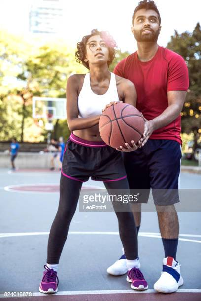 how to play basketball - making a basket scoring stock photos and pictures