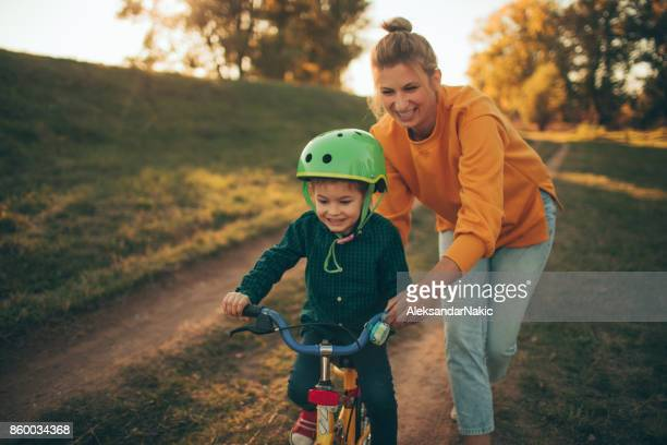 how to ride a bike? - outdoor pursuit stock pictures, royalty-free photos & images