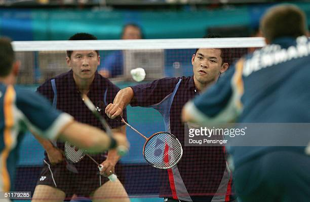 Howard Bach of the USA offers up service in front of teammate Kevin Qi Han against Jens Eriksen and Marti Lundgaard Hansen of Denmark in the men's...