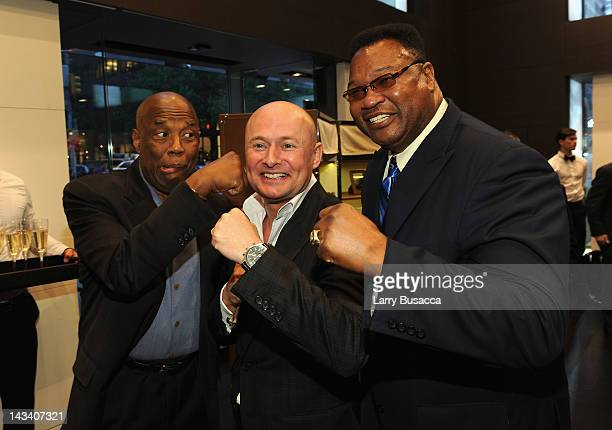 Howard Bingham CEO of IWC Schaffhausen Georges Kern and larry Holmes attend IWC Flagship Boutique New York City Grand Opening at IWC Boutique on...