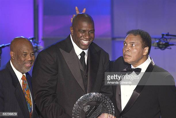 Howard Bingham with founder and host Earvin Magic Johnson and boxer Muhammad Ali are seen on stage during the 20th Annual Midsummer Night's Magic...