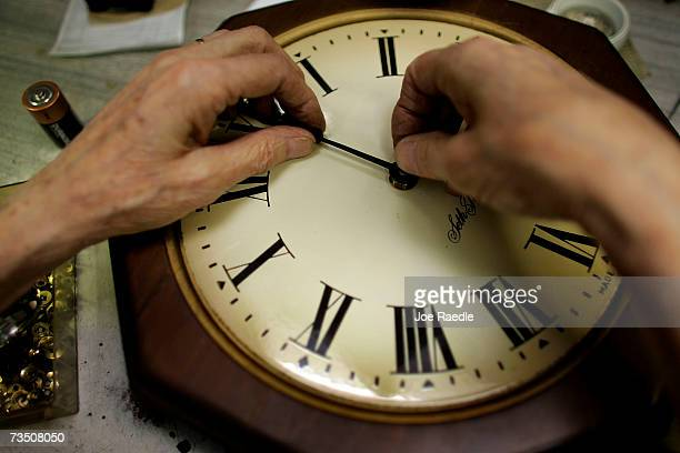Howard Brown repairs a clock at Browns Old Time Clock Shop March 6 2007 in Plantation Florida This year day light savings time happens three weeks...