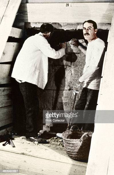 Howard Carter and a colleague excavating a tomb in the Valley of the Kings Egypt 1922 Carter famously discovered the intact tomb of the Pharaoh...
