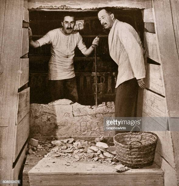Howard Carter and Lord Carnarvon at the opening of King Tutankhamun's tomb in the Valley of the Kings Egypt 1922 Screen print from a photograph
