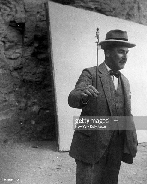 Howard Carter King Tut Egyptian tomb explorer with cane of Tutankhamen First picture received in this country showing Howard Carter Noted American...