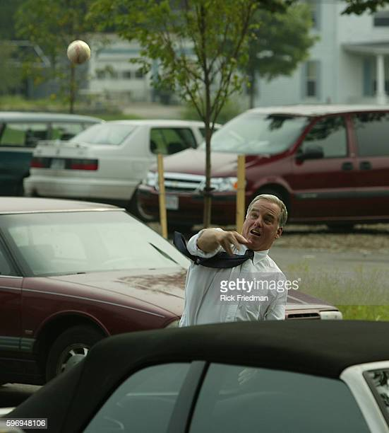Howard Dean returning a foul ball after it landed in the parking lot Dean was campaigning at a softball game between the campaign staffs of Howard...
