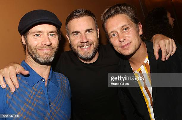 Howard Donald Gary Barlow and Mark of Take That pose backstage at the hit musical Finding Neverland on Broadway The LuntFontanne Theatre on September...