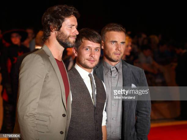 Howard Donald Gary Barlow and Mark Owen attend the world premiere of 'Three Musketeers in 3D' at Vue Westfield on October 4 2011 in London England