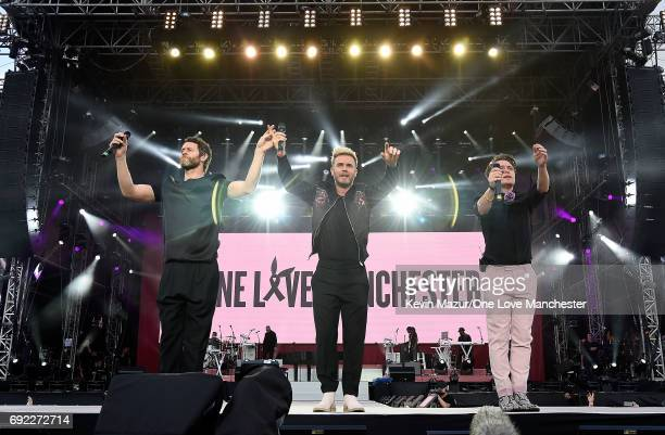 Howard Donald Gary Barlow and Mark Owen of Take That perform on stage during the One Love Manchester Benefit Concert at Old Trafford Cricket Ground...