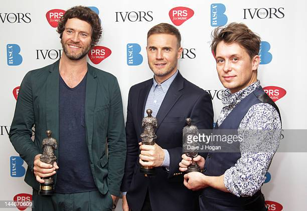 Howard Donald Gary Barlow and Mark Owen of Take That pose in the press room at the Ivor Novello Awards 2012 at Grosvenor House on May 17 2012 in...