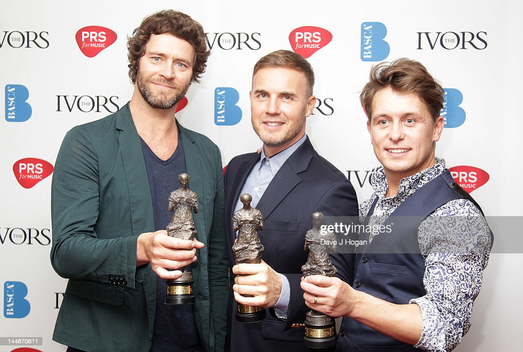 L-R Howard Donald, Gary Barlow and Mark Owen of Take That pose in the press room at the Ivor Novello Awards 2012 at Grosvenor House on May 17, 2012 in London, England.