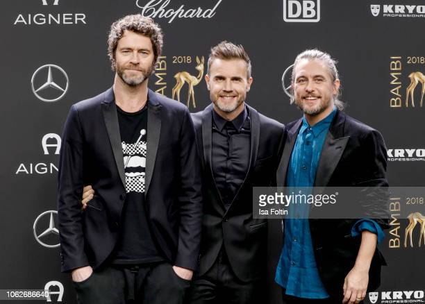 Howard Donald, Gary Barlow and Mark Owen of the band Take That attends the 70th Bambi Awards at Stage Theater on November 16, 2018 in Berlin, Germany.