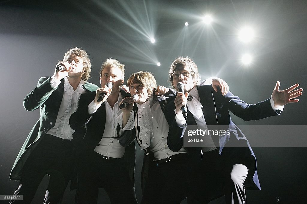 Howard Donald, Gary Barlow, Mark Owen and Jason Orange of Take That perform onstage on their 'Ultimate Tour 2006' at the Sheffield Arena May 2, 2006 in London, England. The group is due to perform 29 dates at venues in Manchester, London, Belfast, Cardiff and Milton Keynes.