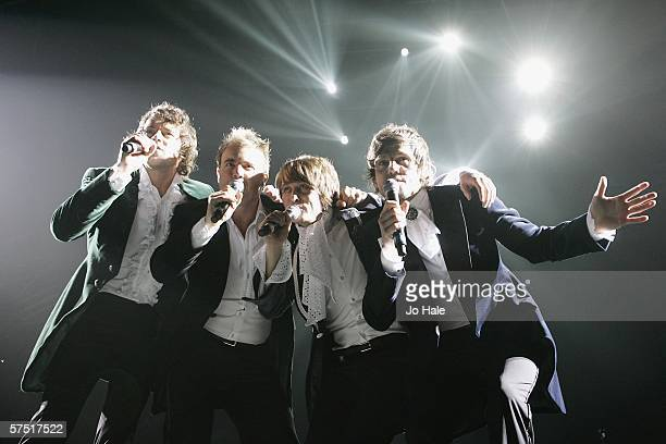 Howard Donald Gary Barlow Mark Owen and Jason Orange of Take That perform onstage on their 'Ultimate Tour 2006' at the Sheffield Arena May 2 2006 in...