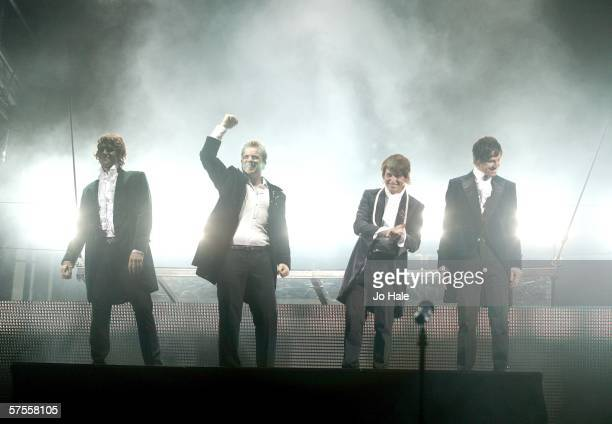 Howard Donald Gary Barlow Mark Owen and Jason Orange of Take That come out on stage as part of their 'Ultimate Tour 2006' tour at Wembley Arena on...