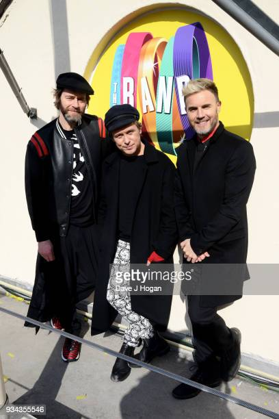 ONLY *** Howard Donald Mark Owen and Gary Barlow of Take That pose on the roof of The Theatre Royal Haymarket on March 19 2018 in London England
