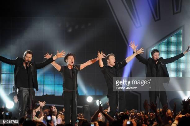 Howard Donald, Mark Owen, Gary Barlow and Jason Orange of Take That perform on stage at the 40 Principales Awards 2008 at Palacio de los Deportes on...